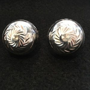 Silver domed earrings.